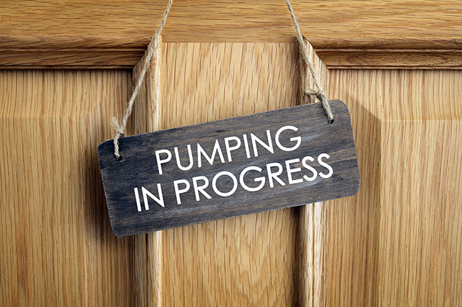 Sign on a door that says pumping in progress